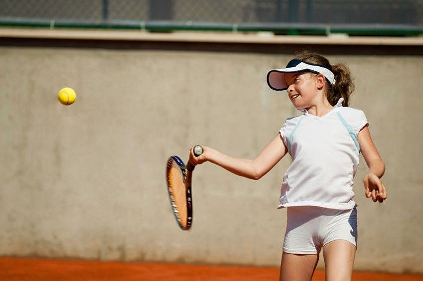 Child Playing Tennis at School Camp